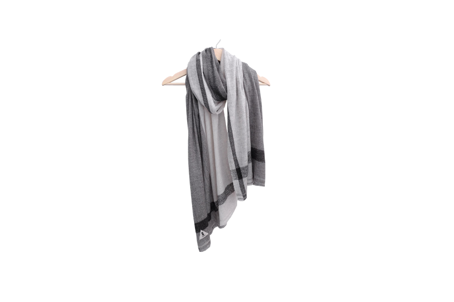 Gray scarf draped around a hanger.