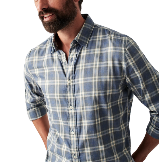 Man in blue and green flannel shirt