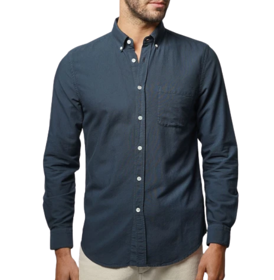 Man wearing a navy flannel shirt and pale chinos